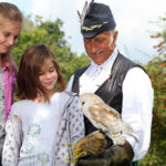 A girl holding a barn owl at Mary Arden's Farm, Warwickshire
