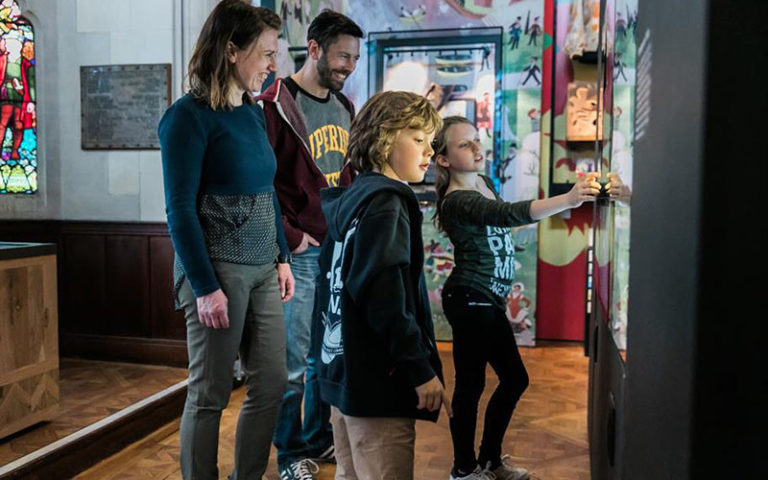 A family enjoying The Play's The Thing Exhibition at the Royal Shakespeare Company