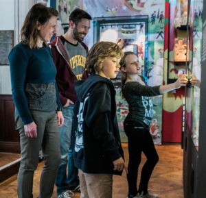 A family enjoying The Play's The Thing' exhibition at Royal Shakespeare Company
