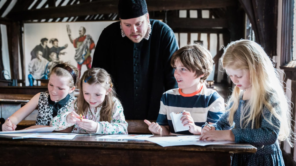 Children at Shakespeare's schoolroom in Warwickshire
