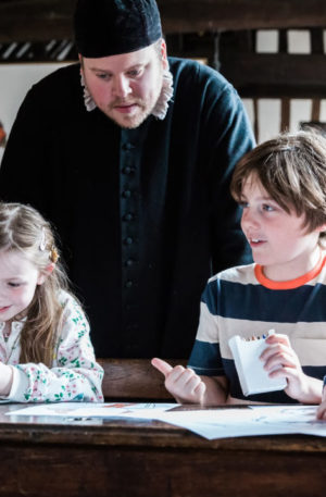 master and children at Shakespeare's schoolroom