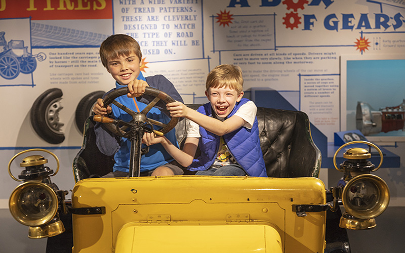 Two boys at the British Motor Museum